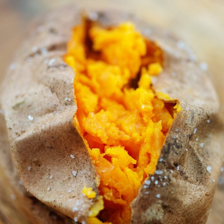 A close up of a split open sweet potato.