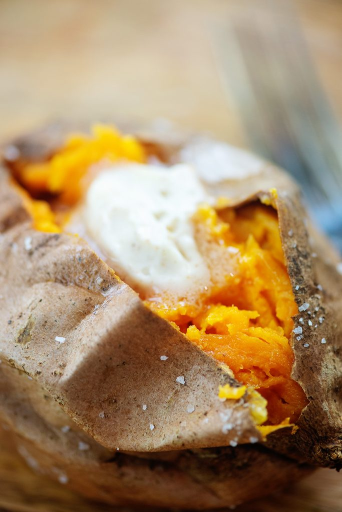 Butter melting inside of a sweet potato.