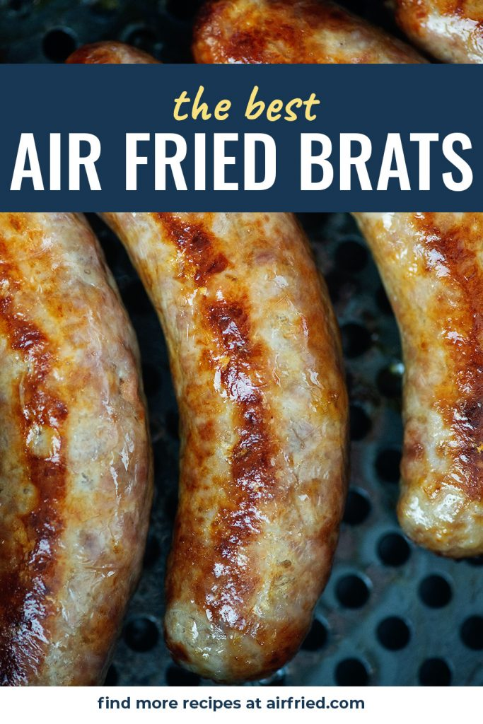 A close up of four bratwursts in an air fryer pan.