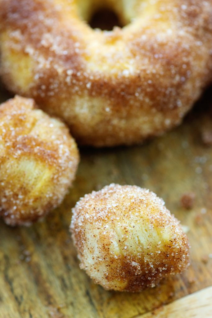 A close up of donut holes covered in cinnamon and sugar