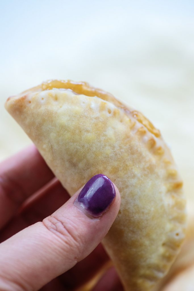 A woman holding a mini apple pie