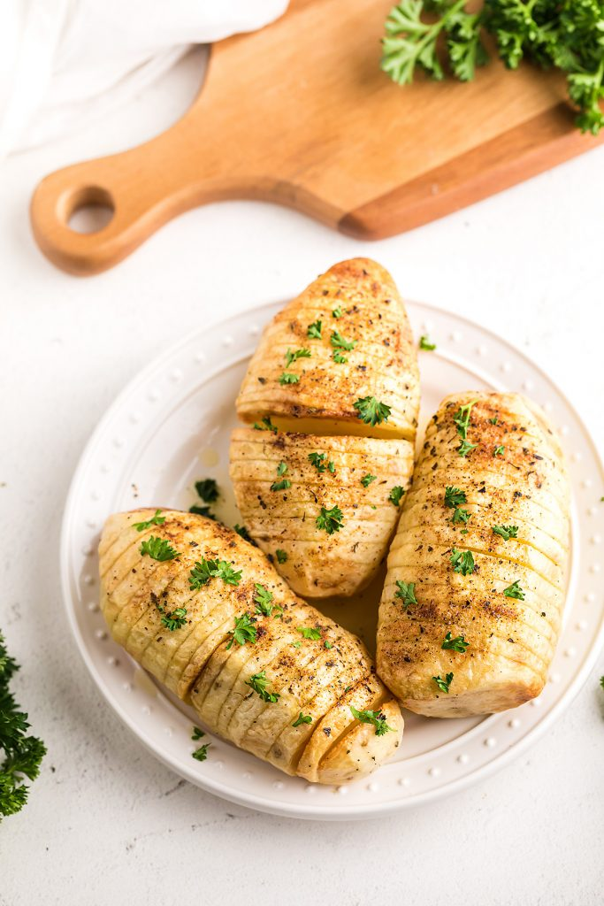 Garlic butter potatoes on a white plate