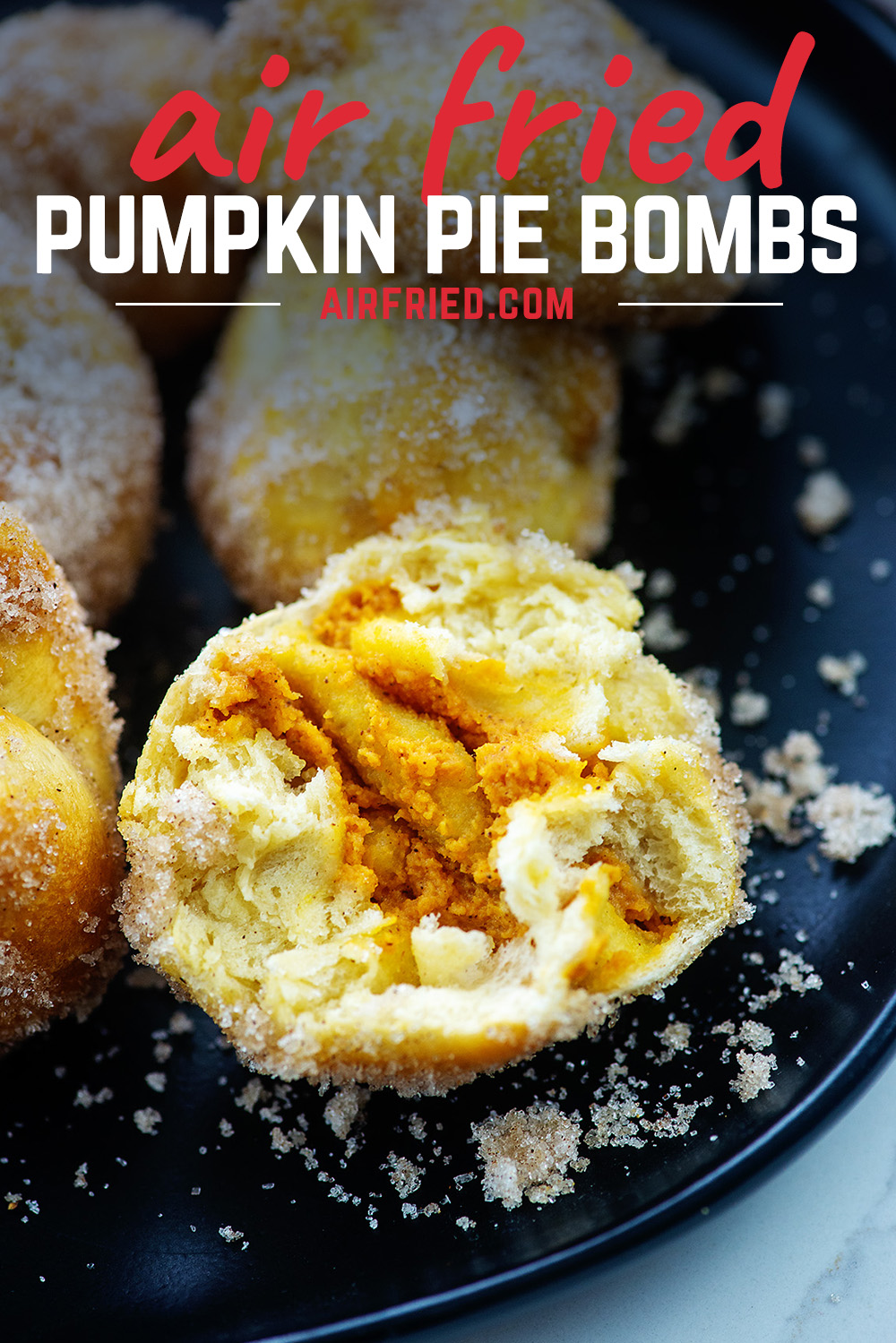 Pumpkin donut bombs filled with pumpkin pie filling and coated in cinnamon sugar. These are so easy in the air fryer. #airfryer #pumpkinrecipes #frieddonuts