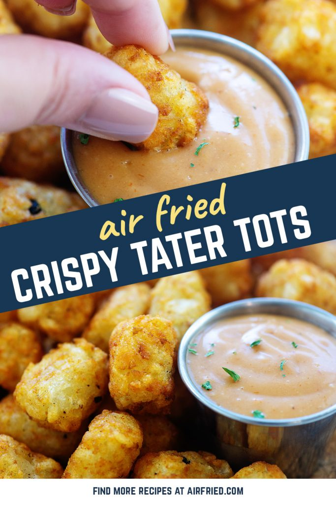 A person dipping a tater tot into sauce.