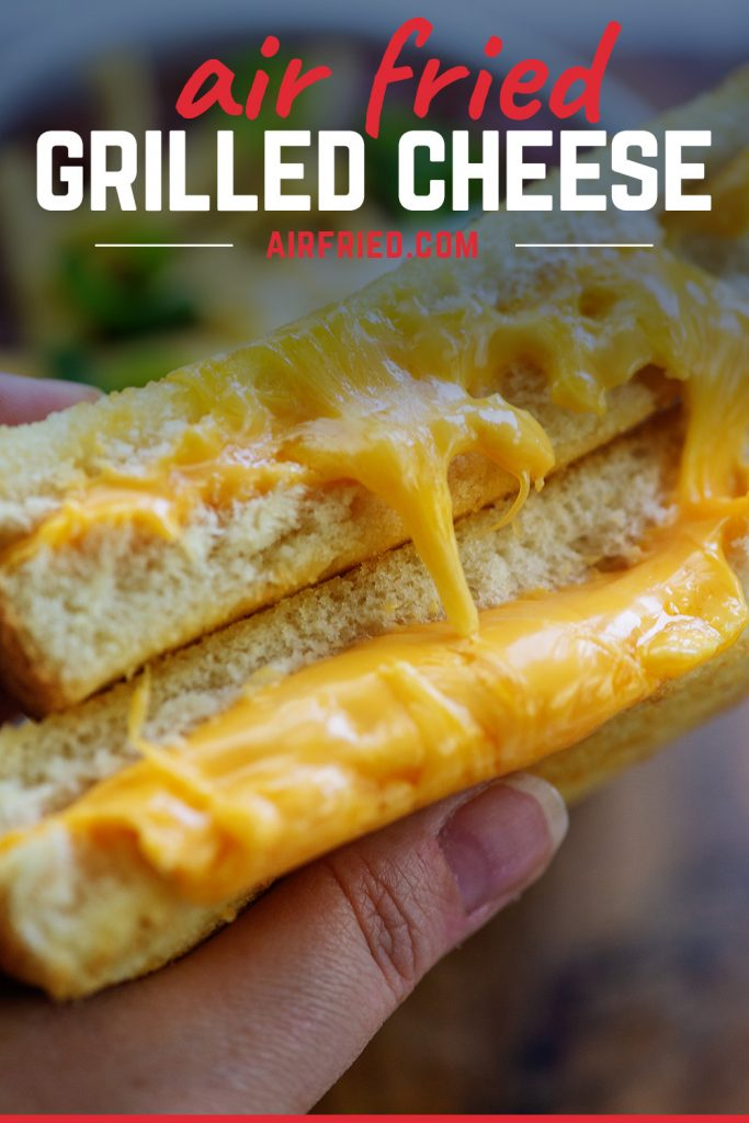 extra cheesy grilled cheese sandwich cut in half