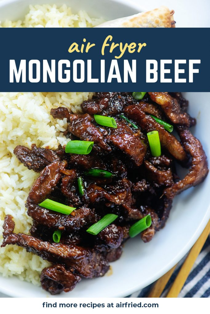 Overhead view of Mongolian beef and rice on a white place.