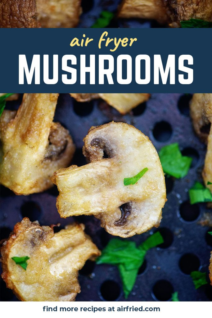 A close up of a few mushrooms in an air fryer basket.
