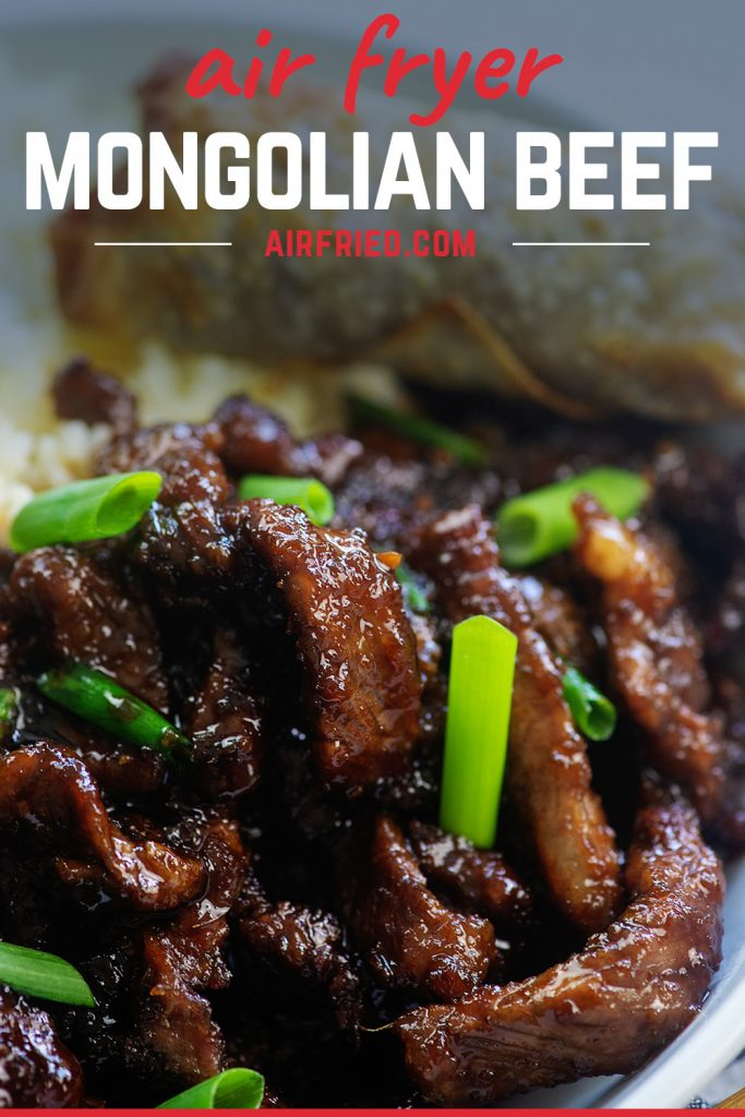 A close up of Mongolian beef with green onions.
