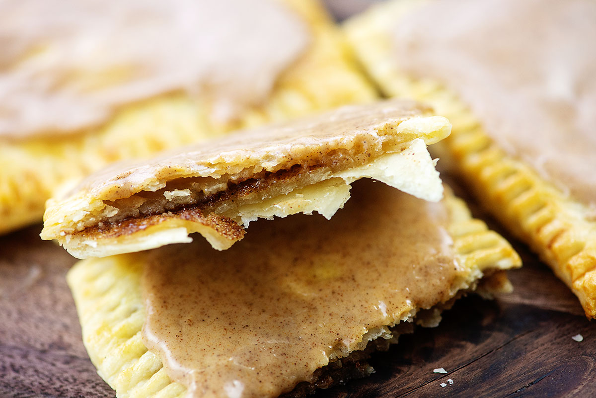 A close up of a pop tart filled with brown sugar and cinnamon split open.