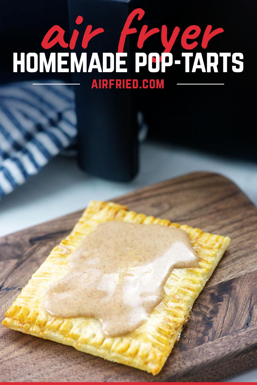 A homemade pop tart on a wooden cutting board
