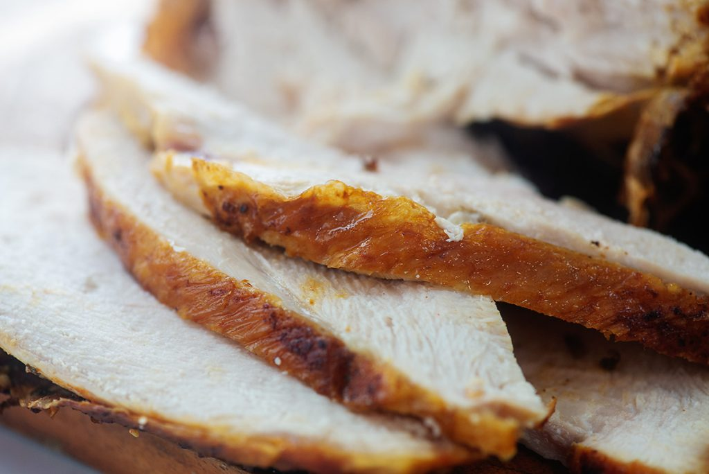 A close up of carved turkey breast