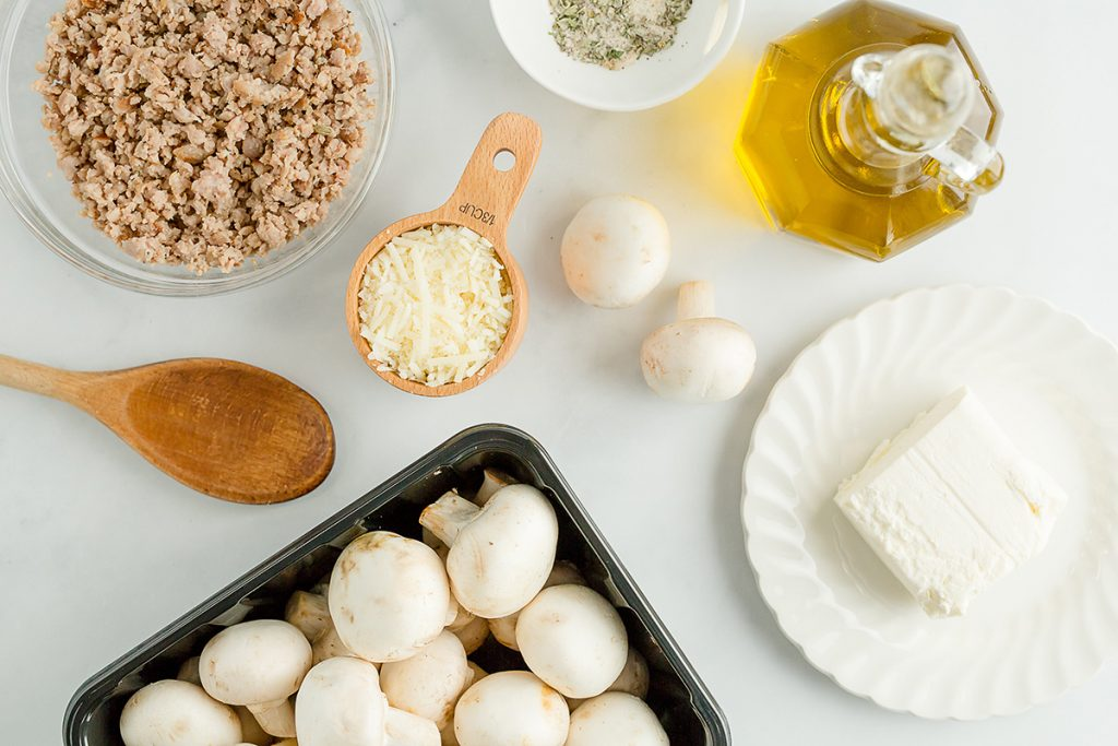 ingredients for stuffed mushrooms spread out on a counter