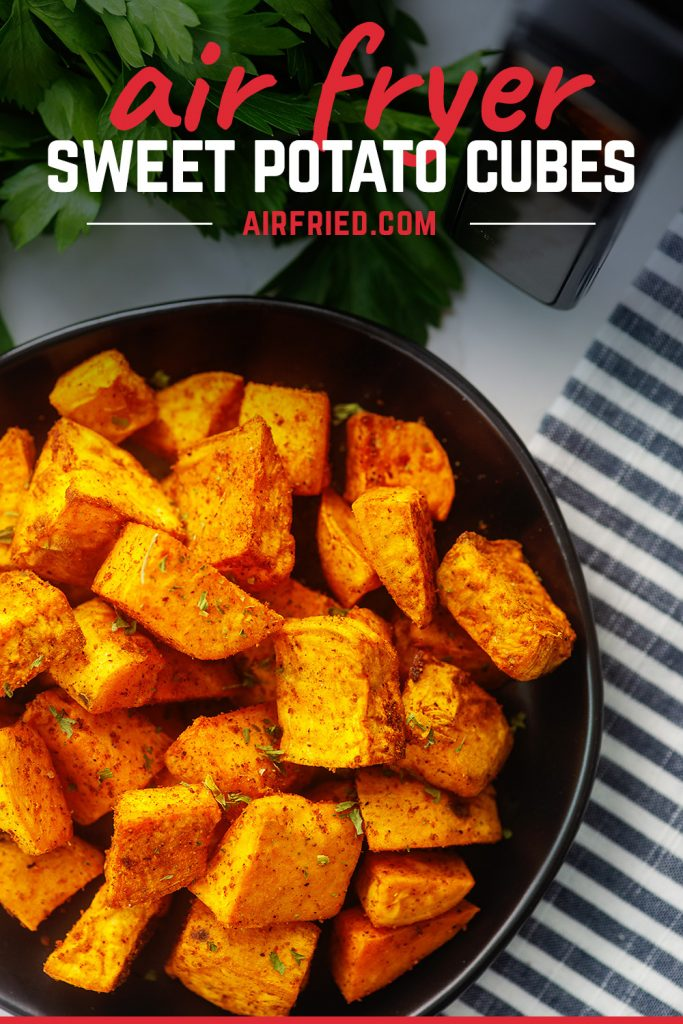 Overhead view of sweet potato cubes on a small black plate