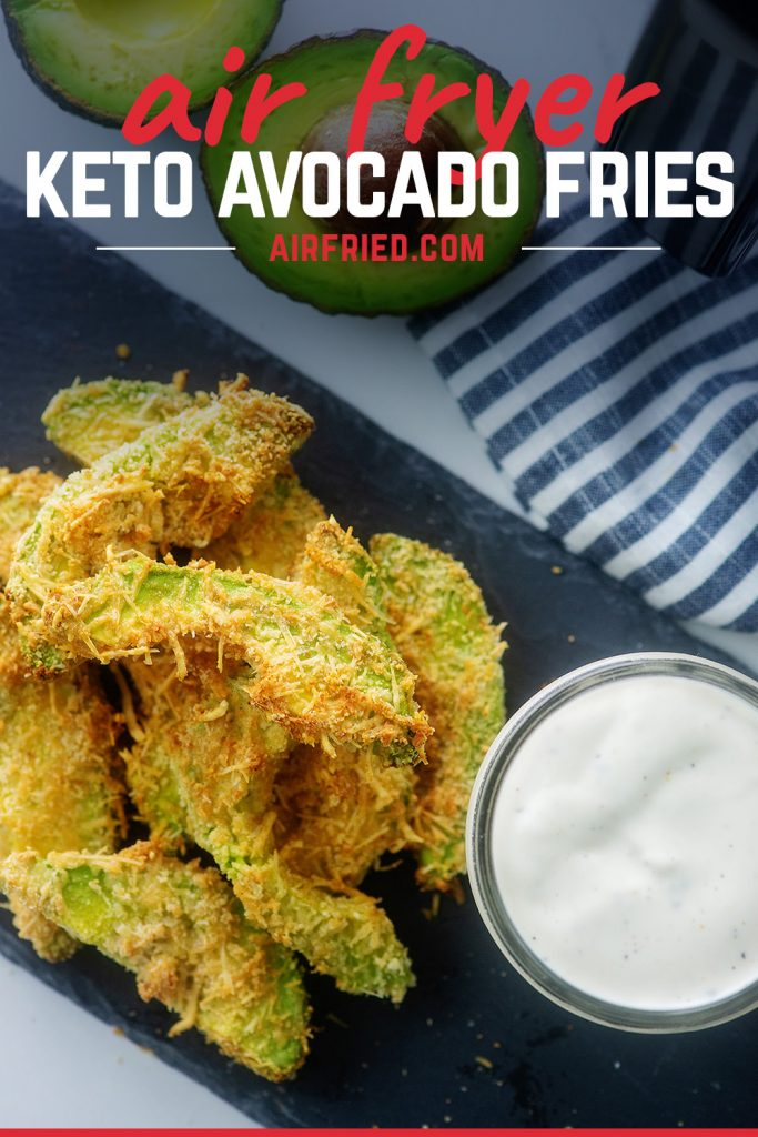 Overhead view of avocado fries next to a cup of ranch dressing.