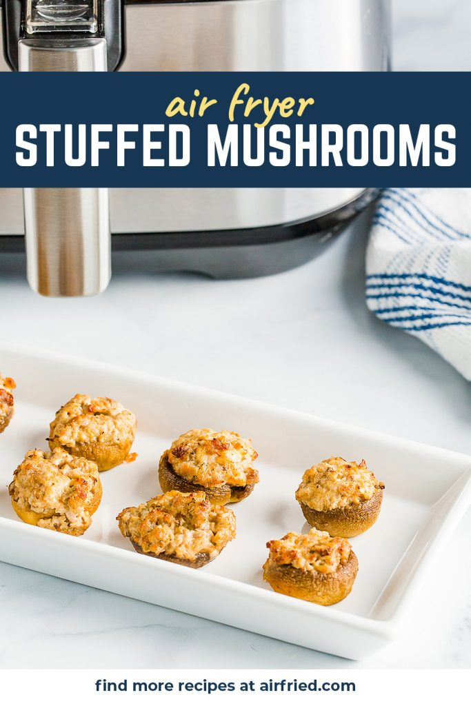 An appetizer dish with lined up stuffed mushrooms.