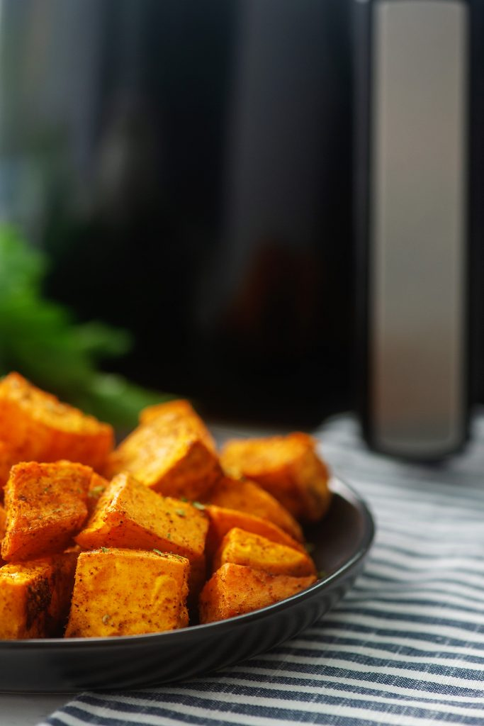 Side view of sweet potato cubes on a plate.