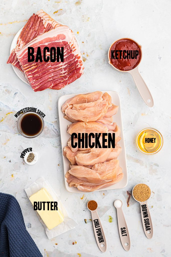 Ingredients for bacon wrapped chicken spread out on a counter