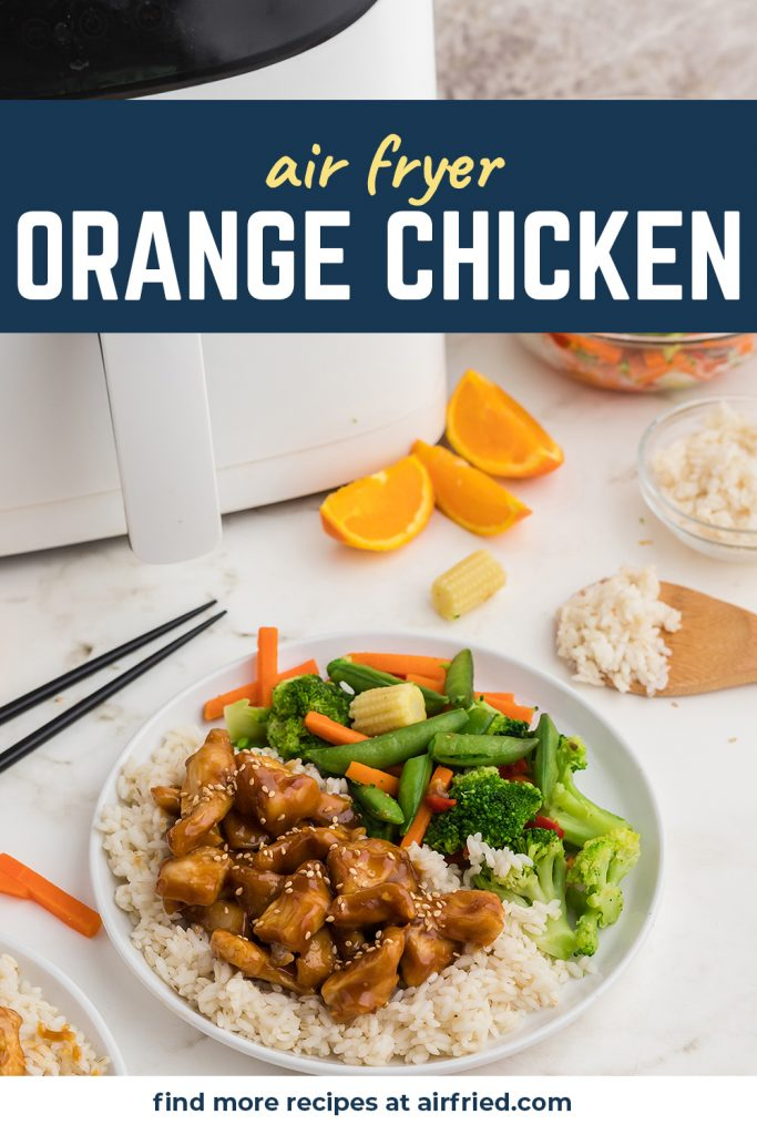 A plate of orange chicken in front of a white air fryer