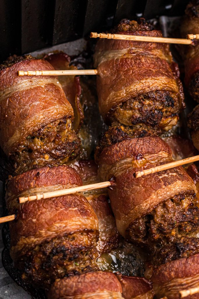 meatballs wrapped in bacon with toothpicks.
