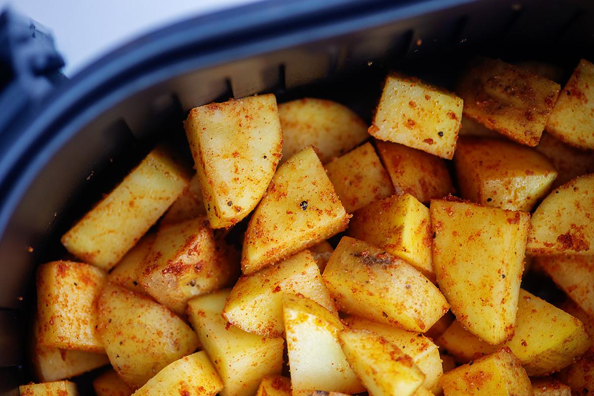 Breakfast potatoes in an air fryer basket