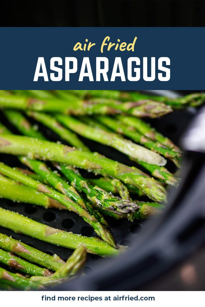A close up of asparagus in an air fryer basket.