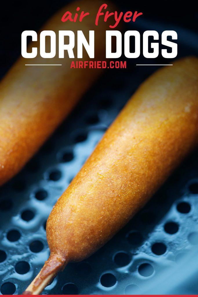 Corn dogs in air fryer basket.