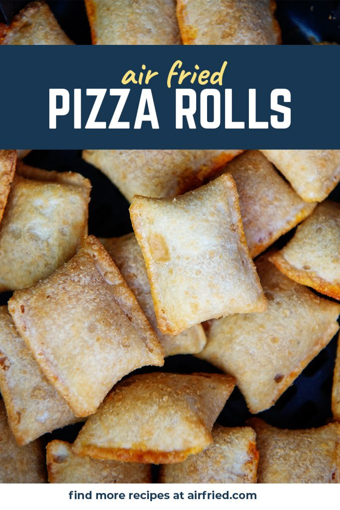 Close up of pizza rolls stacked up in an air fryer basket.