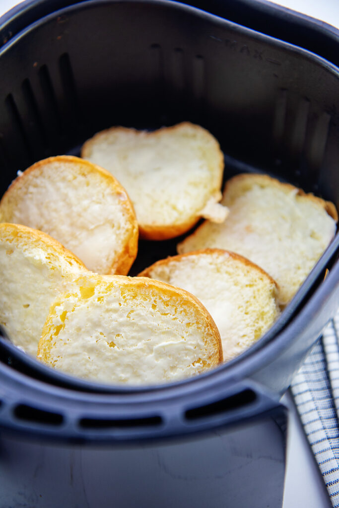 buns stacked up in an air fryer basket