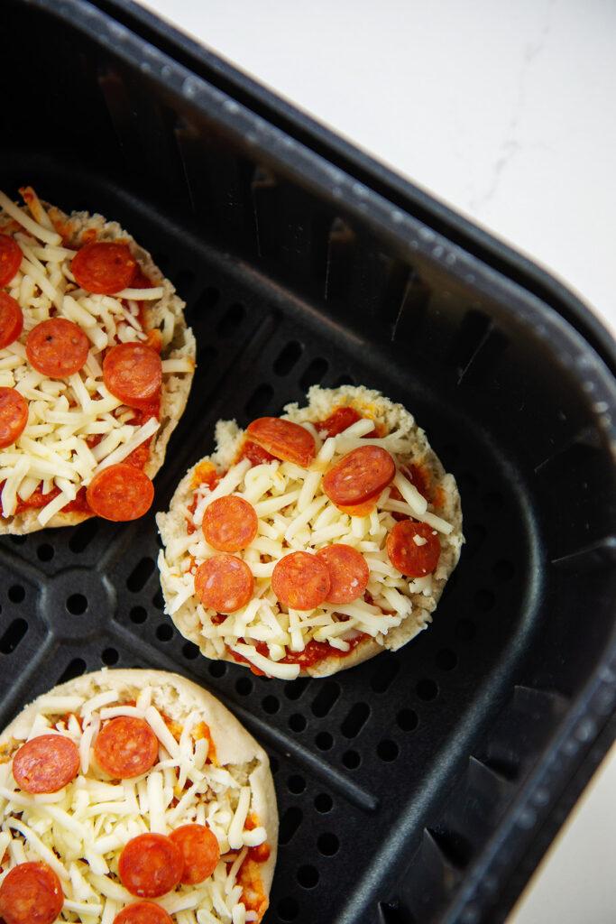 Overhead view of uncooked mini pizzas