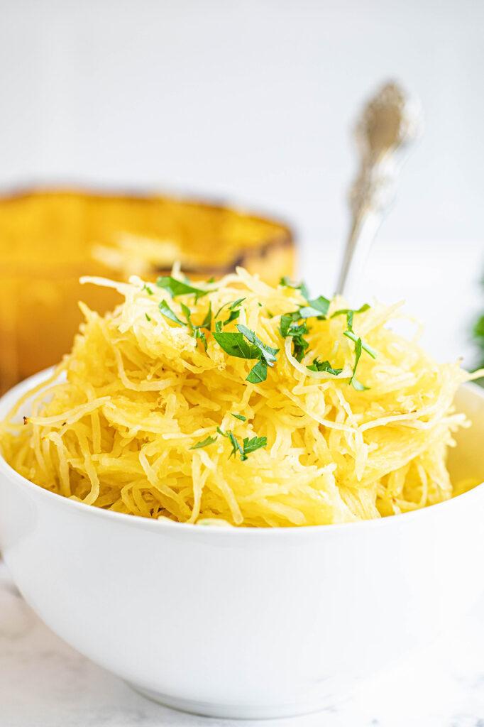 shredded spaghetti squash in a white bowl