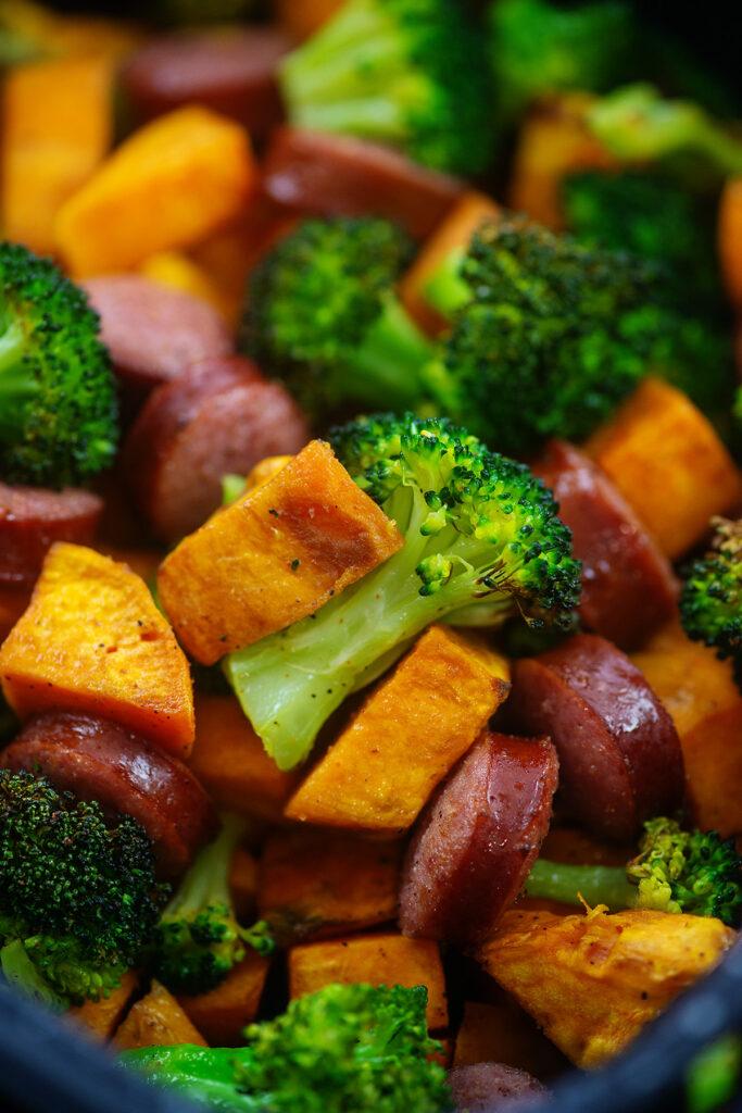 Close up of sweet potatoes, broccoli, and sausage
