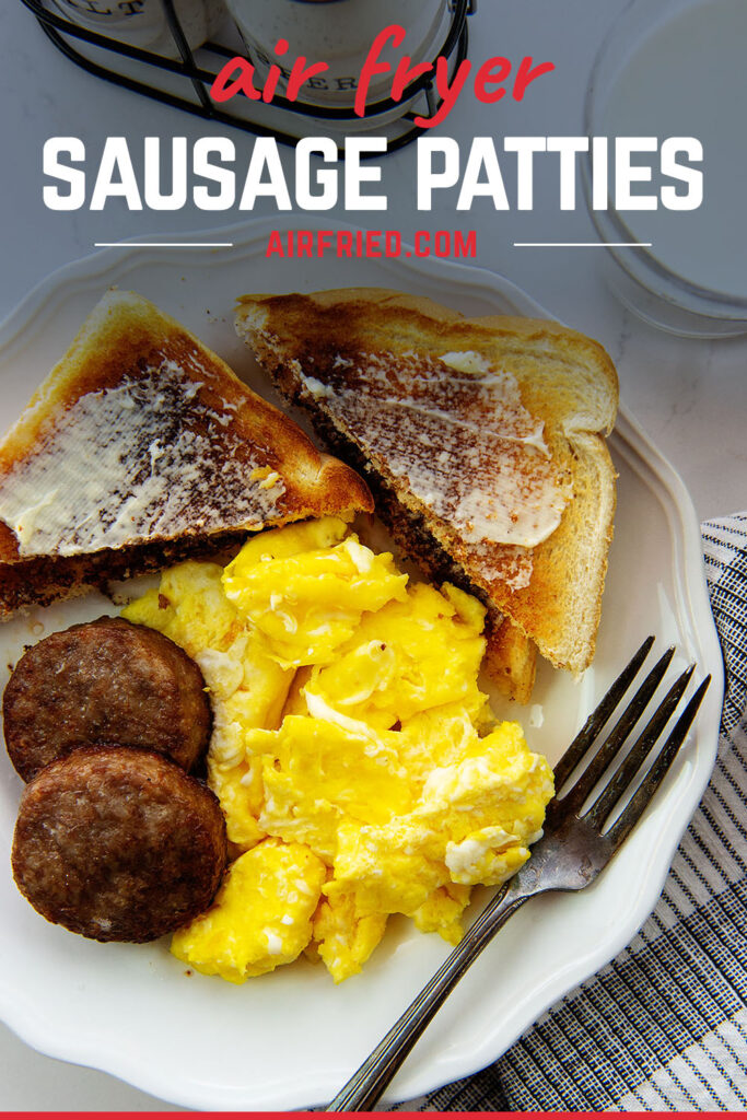 Overhead view of sausage patties on a white plate with scrambled eggs