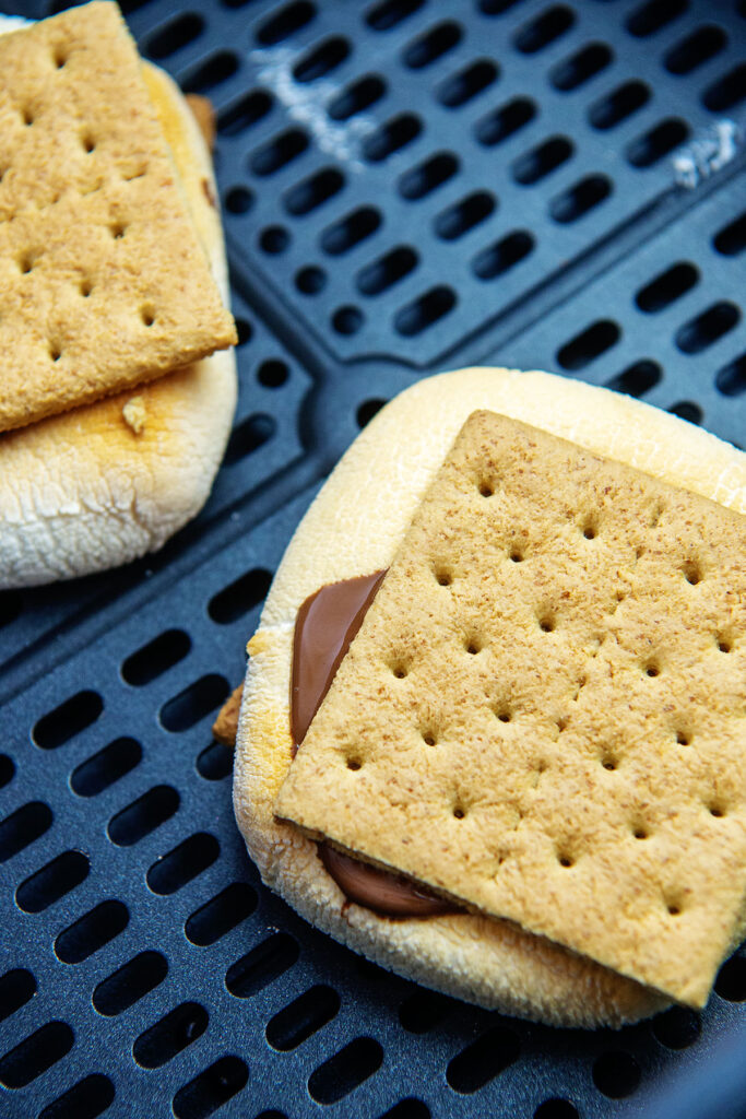 Smores cooking in an air fryer basket