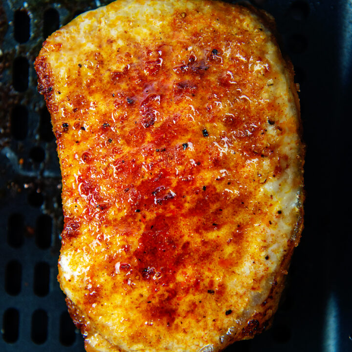 Close up of a cooked pork chop in an air fryer