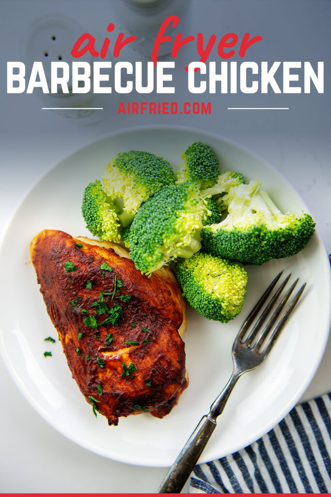 BBQ chicken and broccoli on a white plate