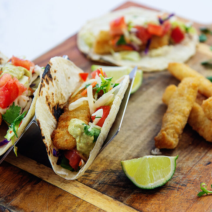 Fish tacos on a wooden cutting board