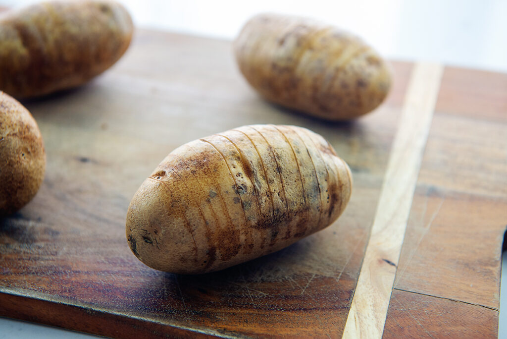 potatoes on a wooden cutting board