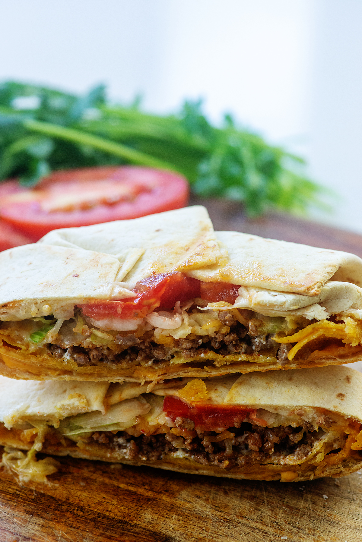 Crunchwrap supreme cut in half and stacked on top of itself