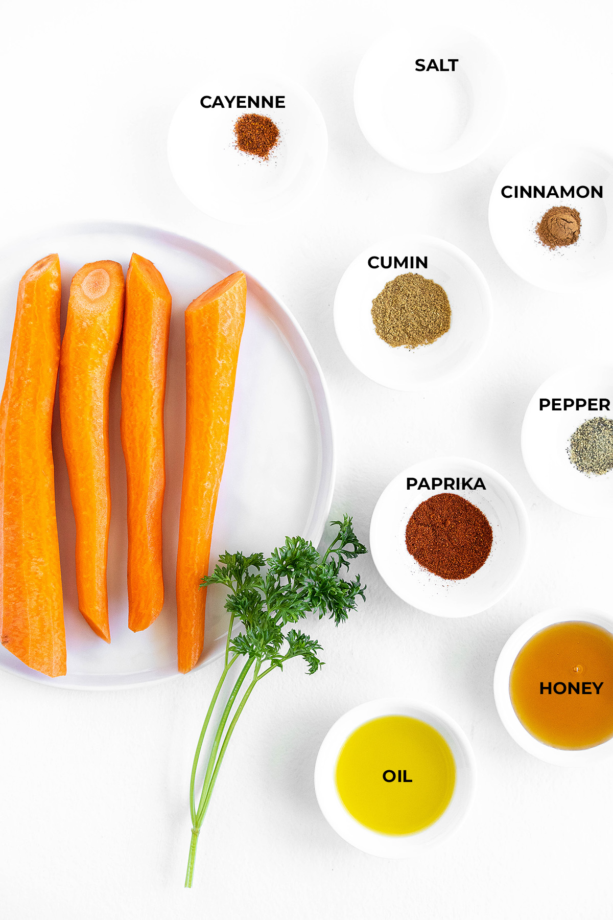 Ingredients for glazed carrots spread out in separate dishes
