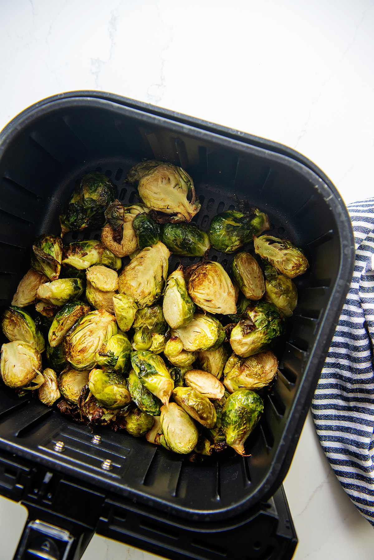 Cut brussels sprouts in an air fryer basket