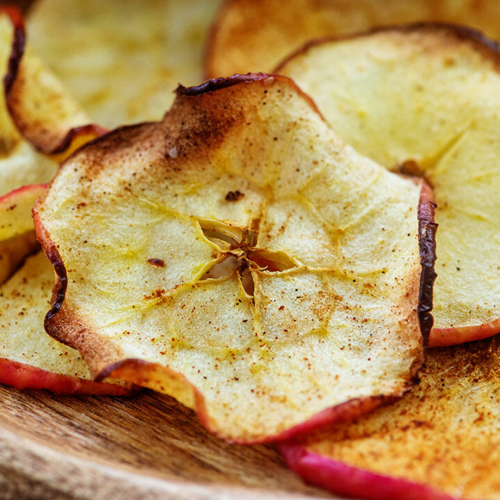 A close up of cinnamon flavored apple chips