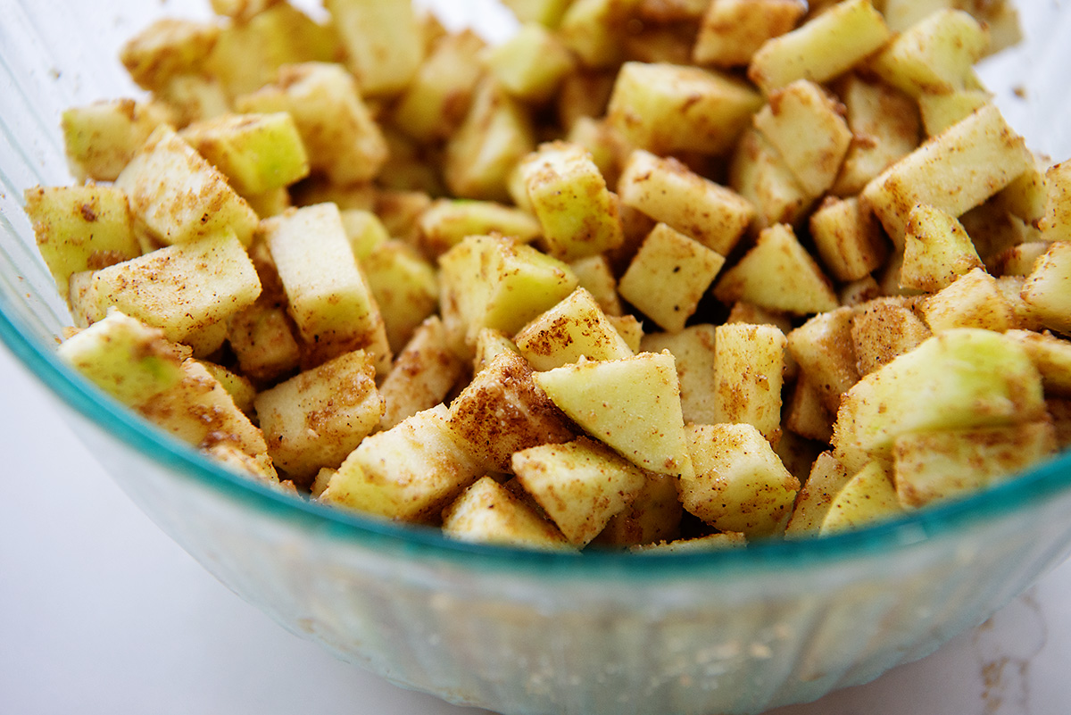 Cinnamon apple cubes in a clear glass bowl