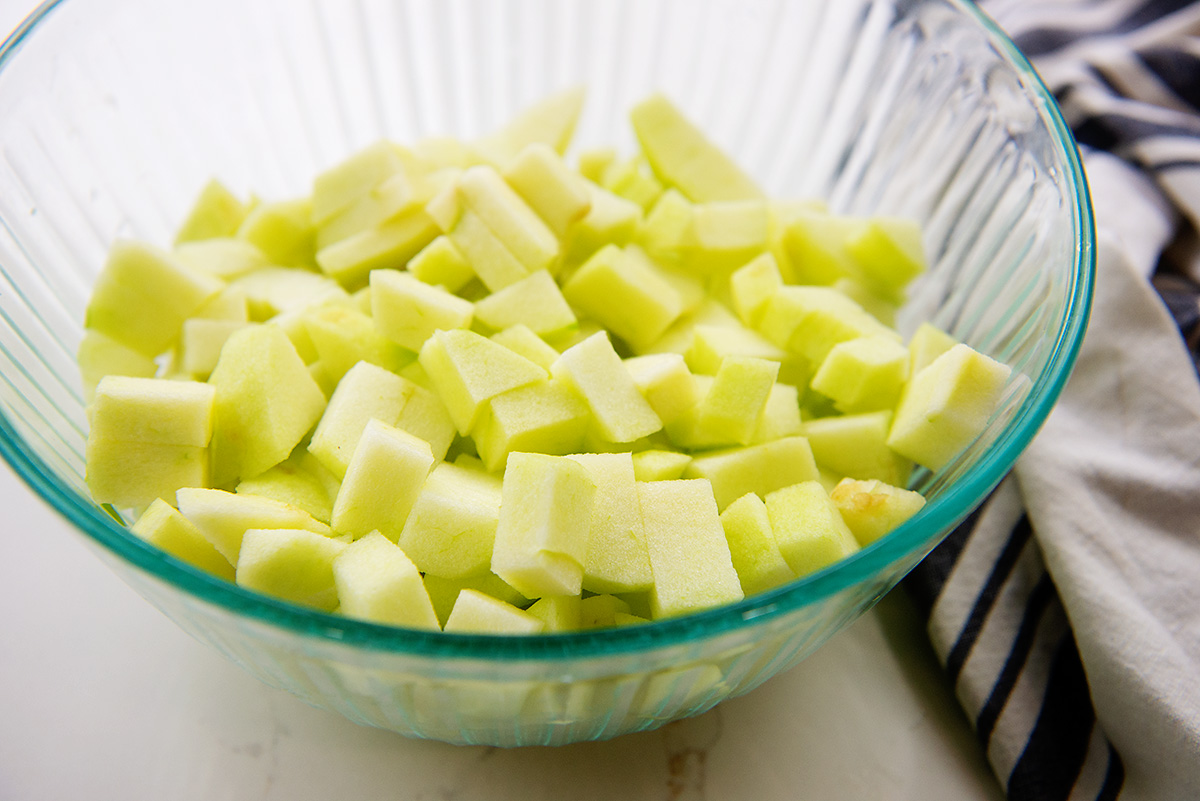 Apple cubes in a clear glass bowl