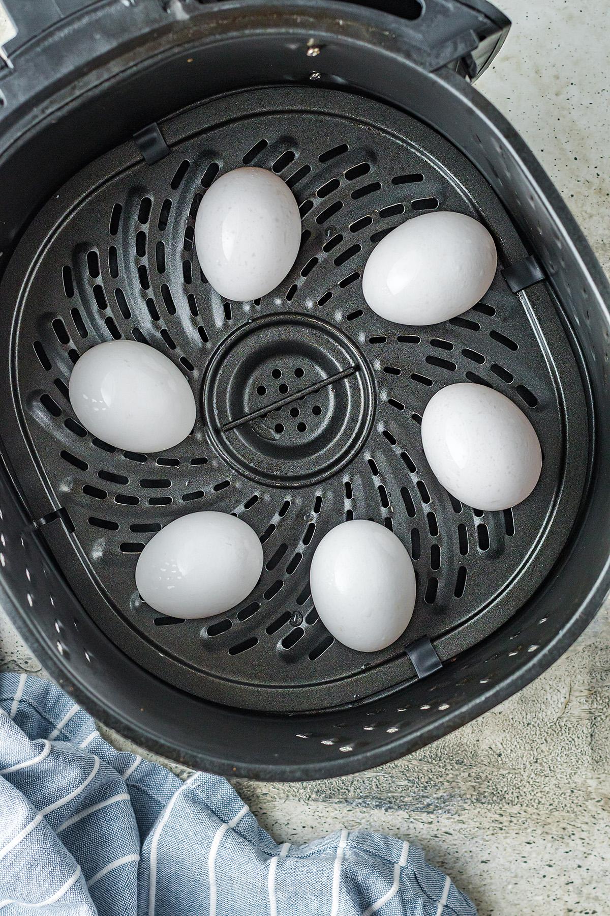 six eggs in an air fryer basket