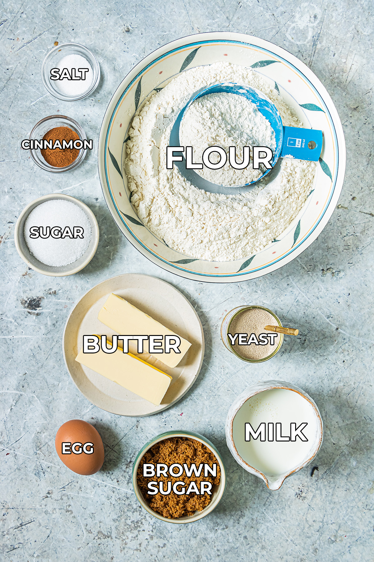 cinnamon roll ingredients spread out on a counter in individual bowls