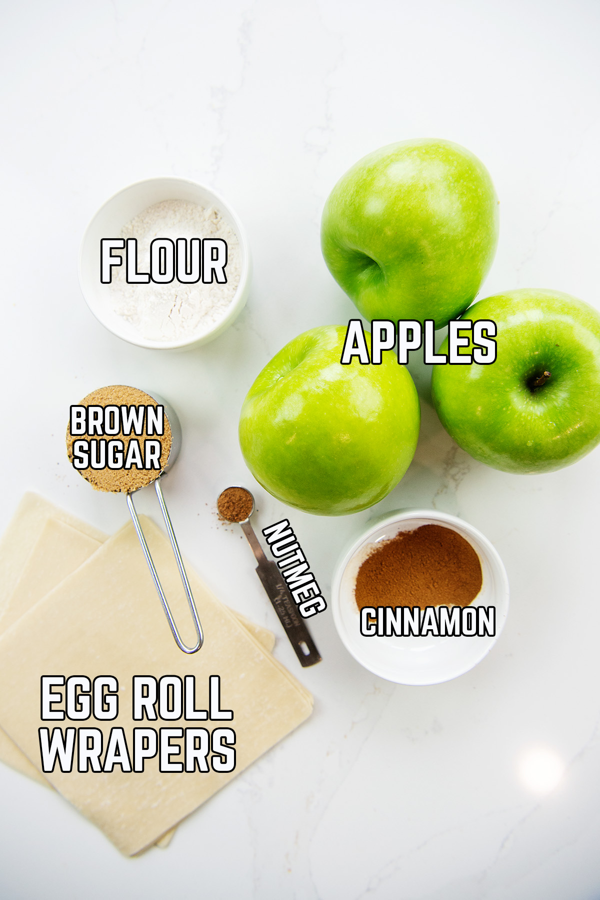 Apple egg roll ingredients spread out on a counter