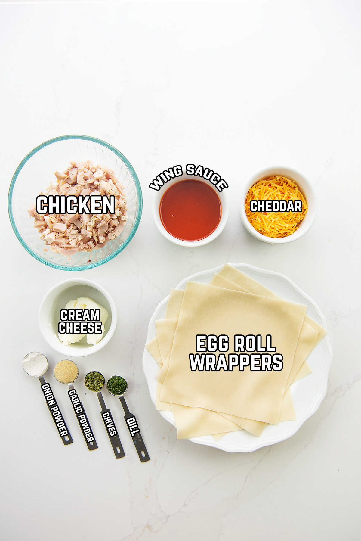 ingredients for buffalo chicken egg rolls spread out