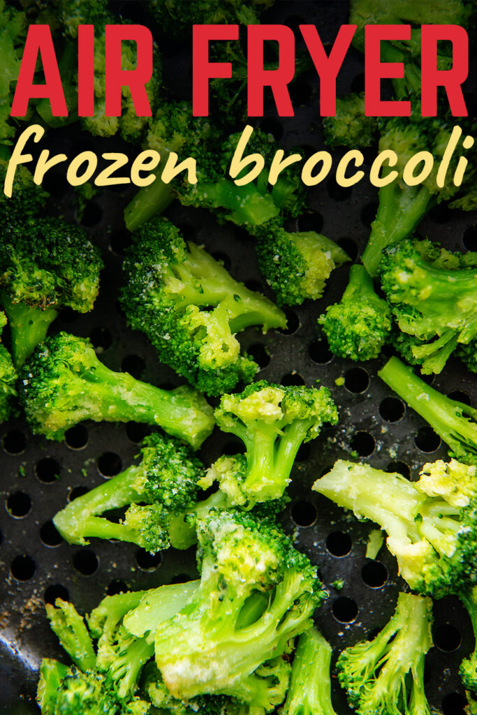 Close up of broccoli in an air fryer basket