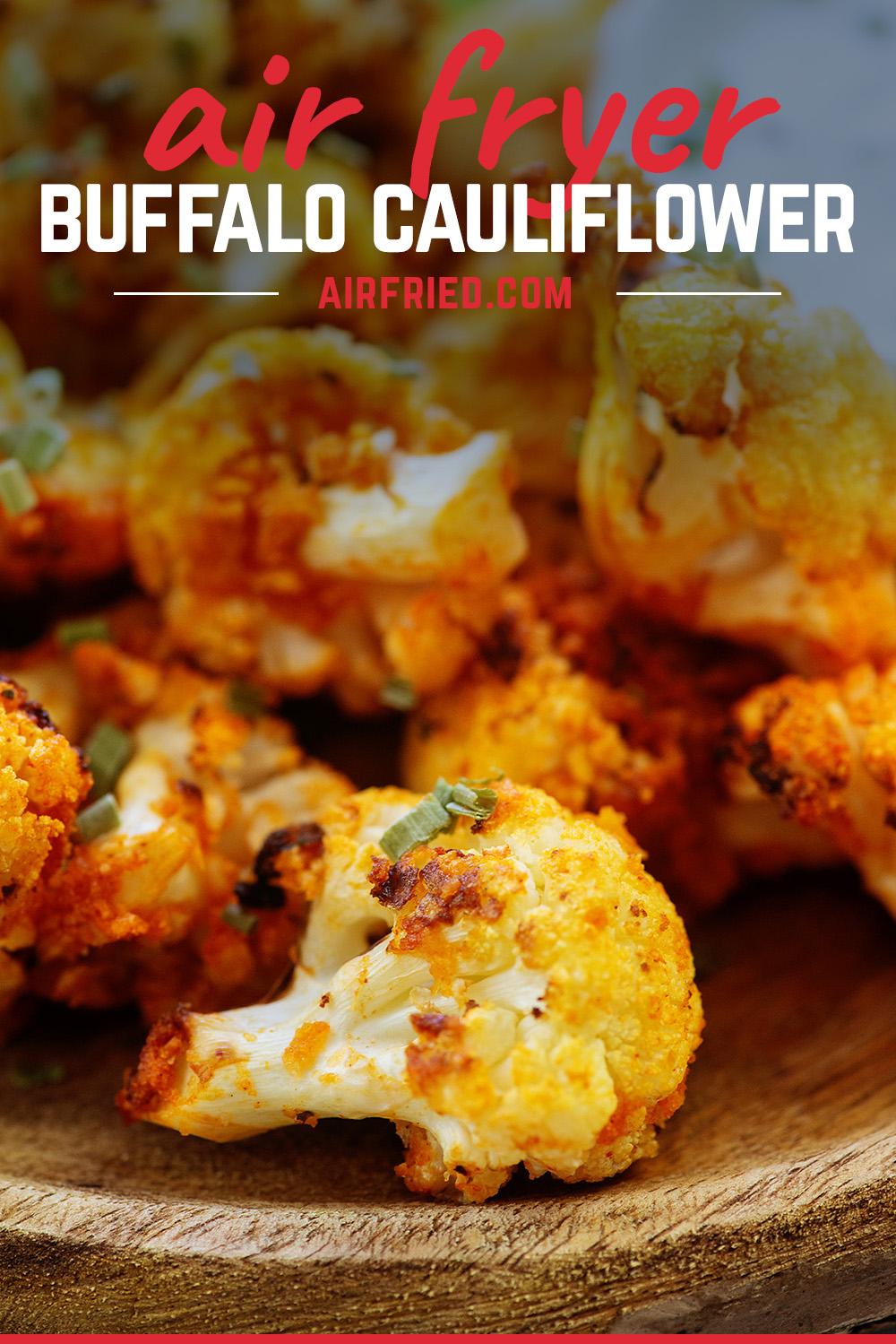 Buffalo cauliflower on a wooden plate up close.
