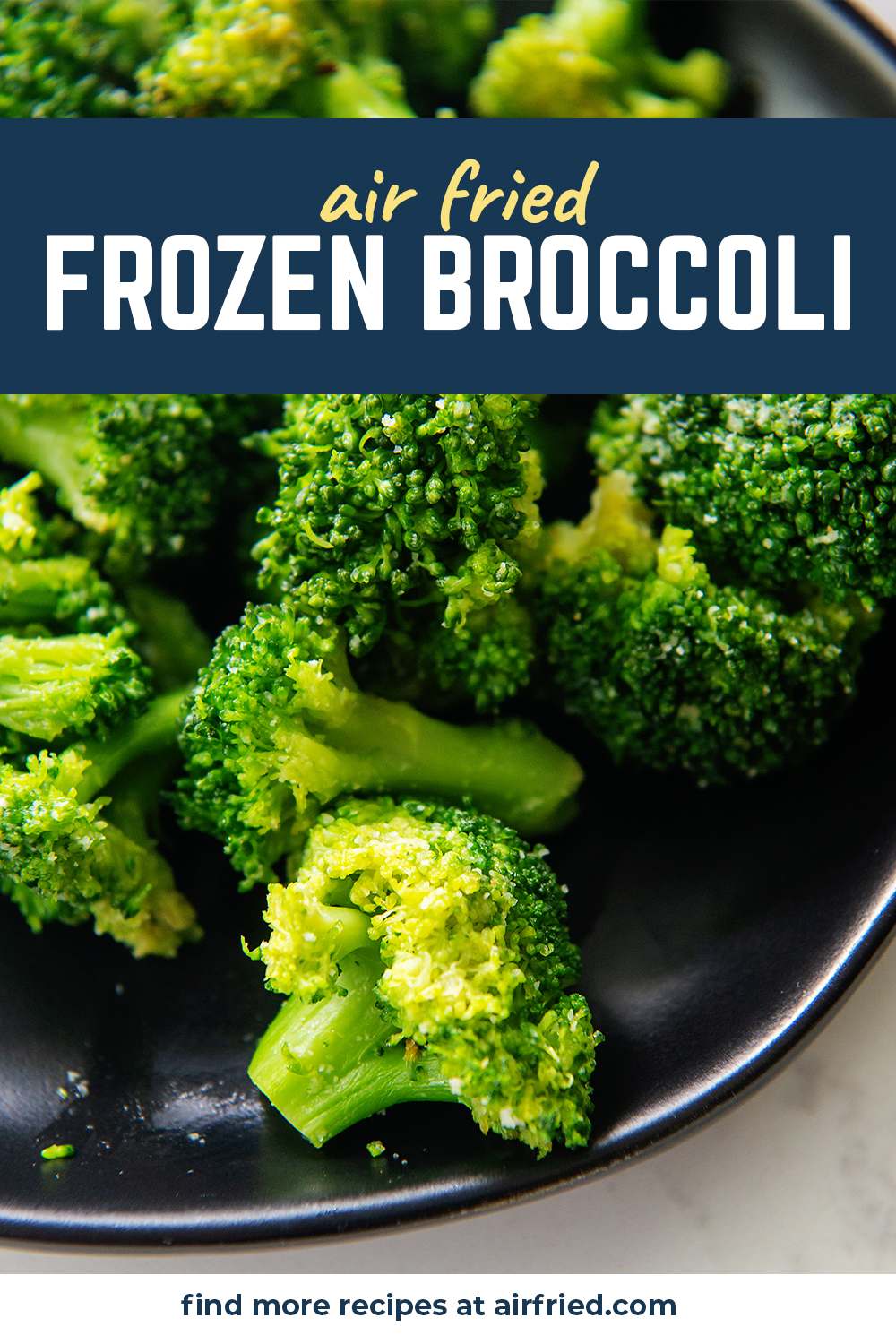 Close up of broccoli on a black plate